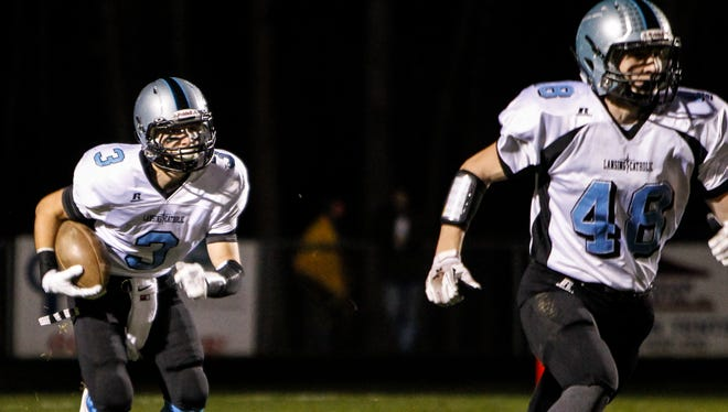Ryan Ruiter (3) and Eli Whitney, right, will try to help Lansing Catholic reach the playoffs for an eighth straight year this fall. The Cougars have won a combined 24 games the last two seasons.