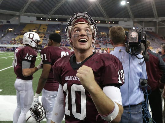 Dowling Catholic quarterback Ryan Boyle celebrates on the sideline in the waning seconds against Cedar Rapids Washington in the Iowa Class 4-A state football championship game on Nov. 21, 2014.
