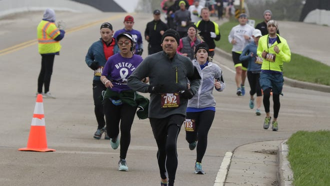 Oshkosh Marathon runners run along Lake Butte Des Morts Drive.  Oshkosh Marathon got off with out a hitch as the weather cooperated and saw 1600 participants start the Oshkosh Marathon, Half Marathon, Corporate Marathon Relay, Half Relay & 5k run on April 30, 2017.