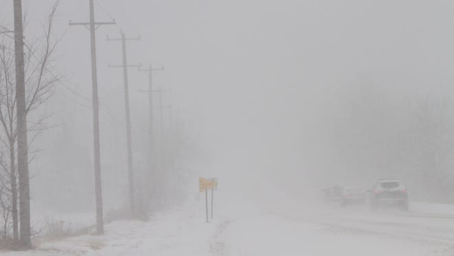 Near-whiteout conditions make driving on Grand River between Howell and Fowlerville a challenge Tuesday evening.