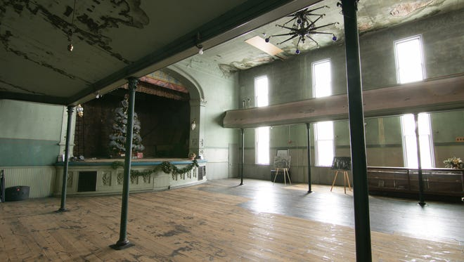 The second floor of the Howell Opera House, shown Wednesday, Dec. 13, 2017, illuminated only by the daylight coming through the recently restored windows due to the need for rewiring of that floor, is unheated with the need for a new furnace.