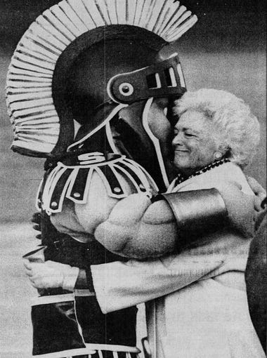 MSU's Sparty only shook the hand of President George H.W. Bush, but gave Barbara Bush a big hug as the president and his wife arrived at the airport for the presidential debate, Oct. 19, 1992.