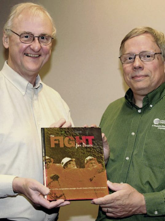 """Adams Electric history book garners gold award: A book chronicling the history of Adams Electric Cooperative and authored by two Gettysburg residents has won a gold award from the National Rural Electric Cooperative Association's Council of Rural Electric Communicators. """"The Fight for Power: An electric cooperative changes south central Pennsylvania forever"""" was released in the summer of 2014 at the beginning of the cooperative's 75th anniversary year. It was selected as part of the Council's 2015 Spotlight on Excellence awards. Co-authors Jim Krut, left, and Duane Kanagy spent over two and a half years researching and writing the 136-page work. Krut is Adams Electric's former vice president of communications/community services who retired in 2009. Kanagy is currently the co-op's manager of communications/community services."""
