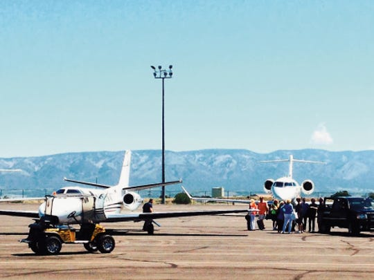 Holidays and tourist seasons fill hangars and outside aircraft parking space at Sierra Blanca Regional Airport.