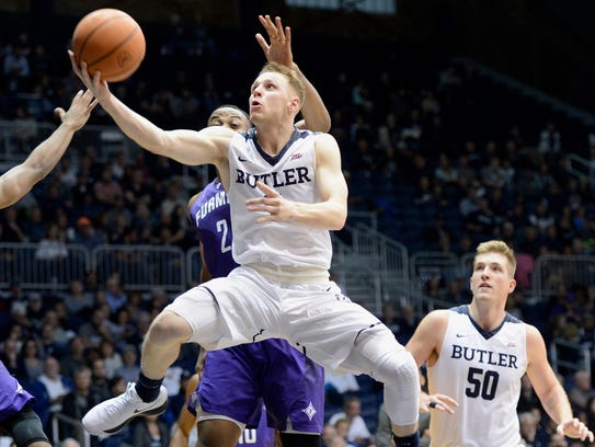 Paul Jorgensen goes in for a layup against Furman on