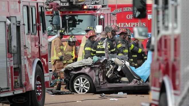 Firefighters work the scene of a crash on Holmes Road and Crumpler where three teen boys were killed in the accident involving an 18-wheeler on Feb. 13.