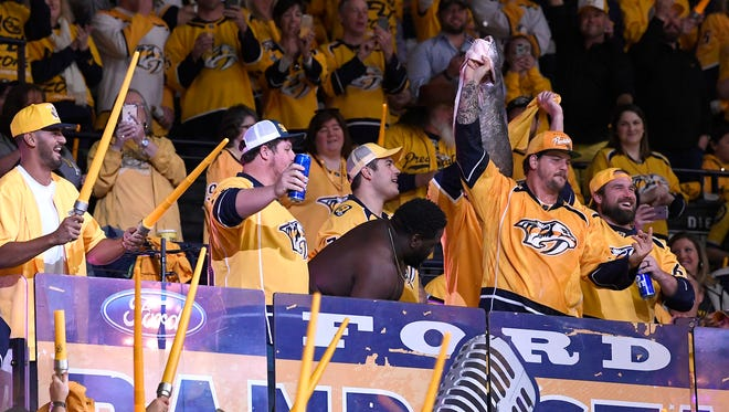Titans quarterback Marcus Mariota and the team's offensive line cheer the Predators before Game 2 of the second round NHL Stanley Cup Playoffs at the Bridgestone Arena Sunday, April 29, 2018, in Nashville, Tenn.