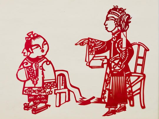 Mr. Chang Yu-Wei's original paper cutting art of an opera scene at a preview of the Chinese Festival at the Chinese American Community Center near Hockessin on Thursday.