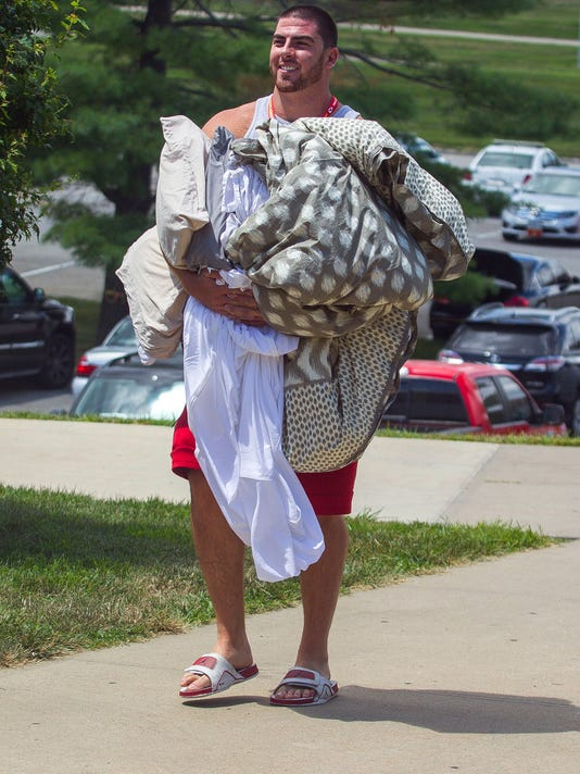 Kansas City Chiefs offensive lineman Eric Fisher walks to Scanlon Hall at Missouri Western State University during move in for NFL football training camp,  Friday July 29, 2016 in St. Joseph, Mo. (Dougal Brownlie/The St. Joseph News-Press via AP)