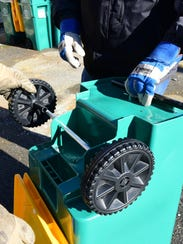 Workers assemble recycling carts at the Chambersburg