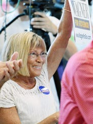 Joanne Burns of Dover Township cheers with a crowd