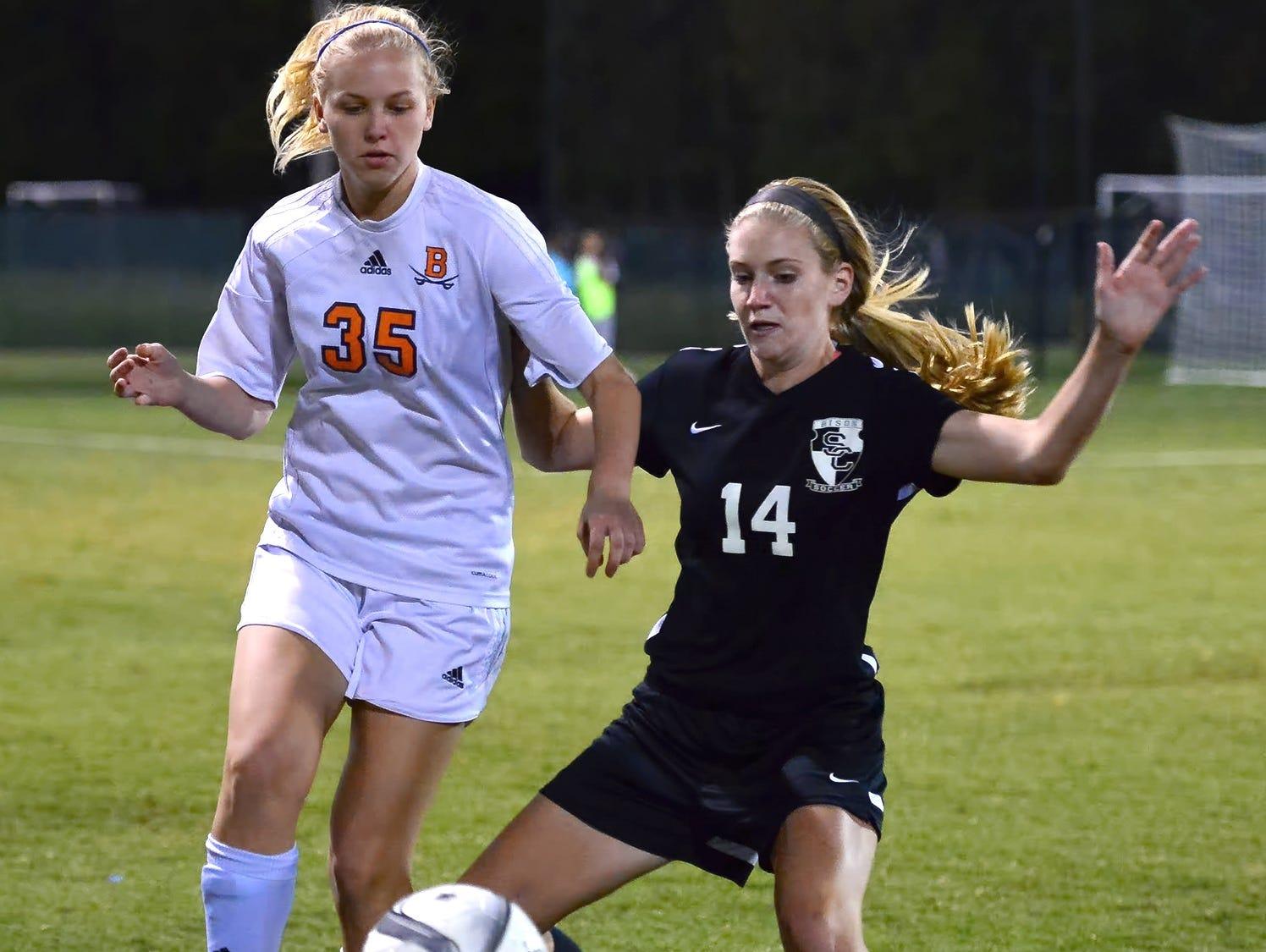 Beech High senior Ana-Carlin Krueger passes to a teammate as Station Camp freshman Morgan Appenrott pressures.