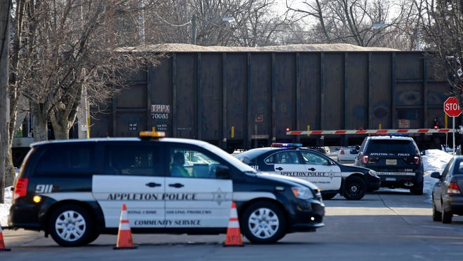 The Appleton Police Department is on the scene near S. Locust and W. Lawrence Streets where a train hit a pedestrian Sunday, February, 5, 2017, in Appleton, Wisconsin.Ron Page/USA TODAY NETWORK-Wisconsin
