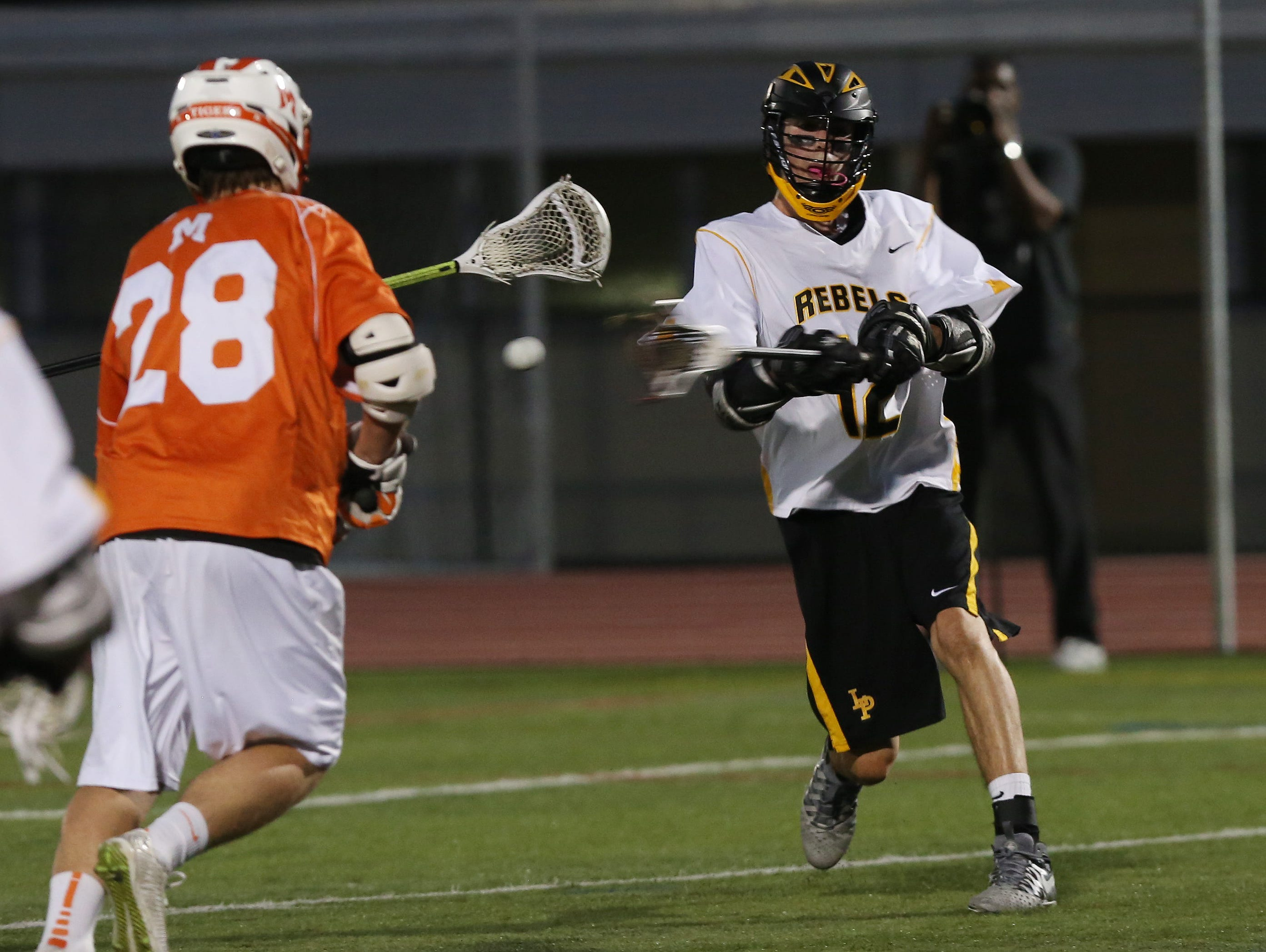 Lakeland/Panas' Drew Thompson (12) fires a shot in front of Mamaroneck's Se' McElroy (28) for a first half goal during the Section 1 championship game at White Plains High School May 25, 2016.