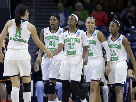 Notre Dame guard Jewell Loyd (32) celebrates with teammates after scoring a basket against Oklahoma State during the first half of an NCAA women's college basketball tournament regional semifinal at the Purcell Pavilion in South Bend, Ind., Saturday, March 29, 2014.