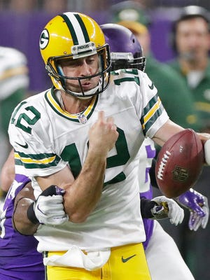 Packers quarterback Aaron Rodgers is stripped of the ball on a scramble against the Minnesota Vikings at U.S. Bank Stadium Sept. 18.