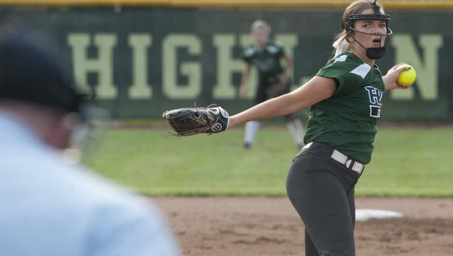 Floyd Central starting pitcher Abby Letson throws to Seymour's Tori Snook.
