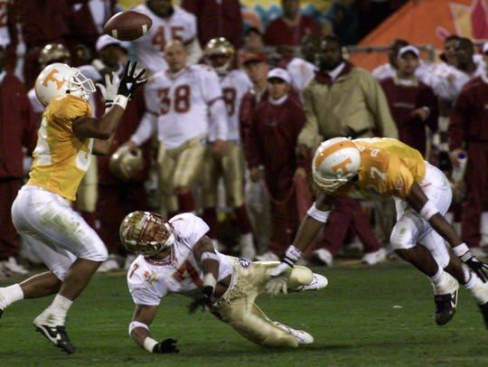 UT's Steve Johnson (34) intercepts a pass intended for Florida State's Laveranues Coles.