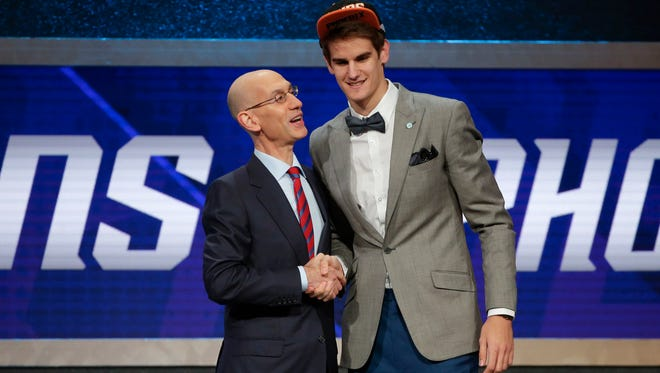 NBA Commissioner Adam Silver, left, congratulates Dragan Bender after Bender was selected fourth overall by the Phoenix Suns during the NBA draft Thursday in New York.