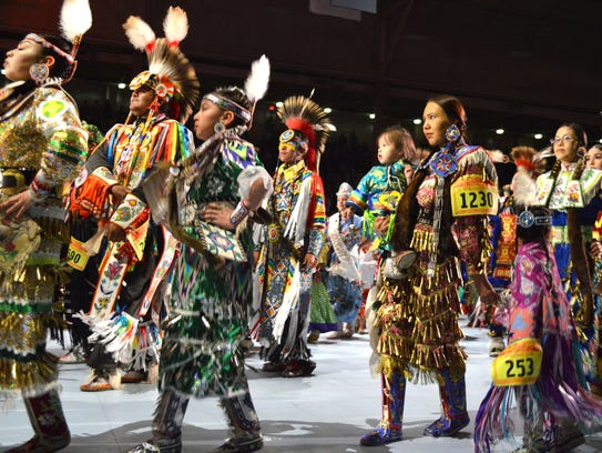 Native American dancers take part in the grand entry
