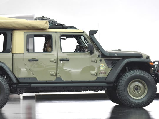 This is the Jeep Wayout, an overlanding concept vehicle, colored in Gator Green.