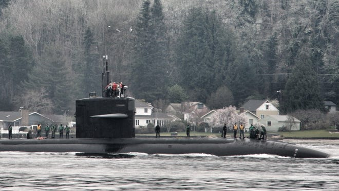 The USS Bremerton arrives in Sinclair Inlet in this file photo.