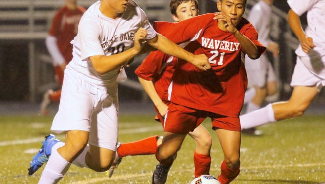 Mitchell Vargas of Notre Dame fights for control of the ball wit hWaverly's Hans Jequinto during Friday's game at Brewer Memorial Stadium.