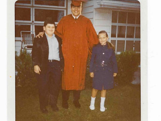 The Bradley siblings, from left, Kevin, Edwin and Pamela, became huge Green Bay Packers fans in the 1960s, even though they lived in Eagles country near Philadelphia.This photo shows the children on Edwin's graduation day from high school.