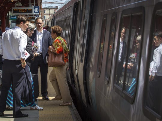 Passengers board an Acela Express in Wilmington on Tuesday afternoon.