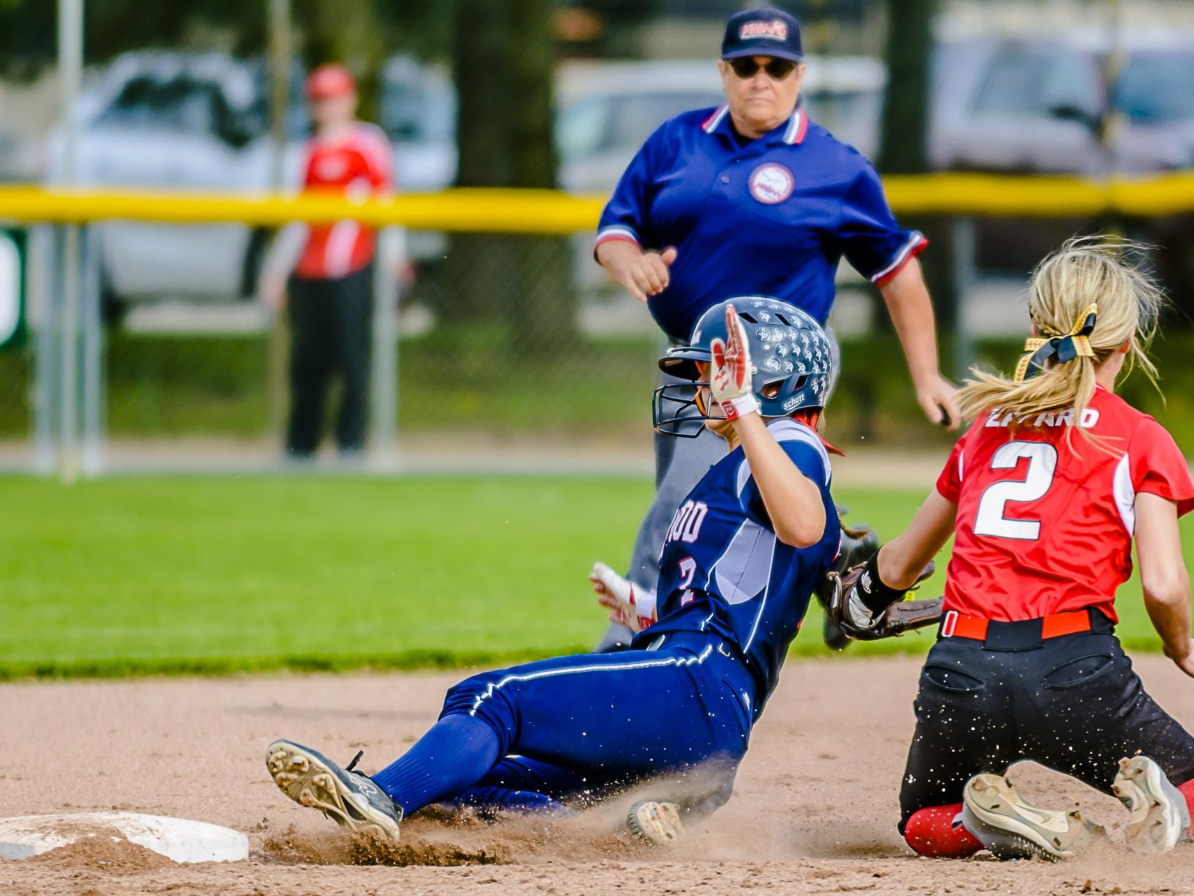 Kennedy Geiger ,left, of Lakewood slides past a tag attempt by Katie Eppard ,2, of Laingsburg to steal 2nd in the 3rd inning of their Softball Classic first round game Tuesday May 17, 2016 at Ranney Park in Lansing. KEVIN W. FOWLER PHOTO
