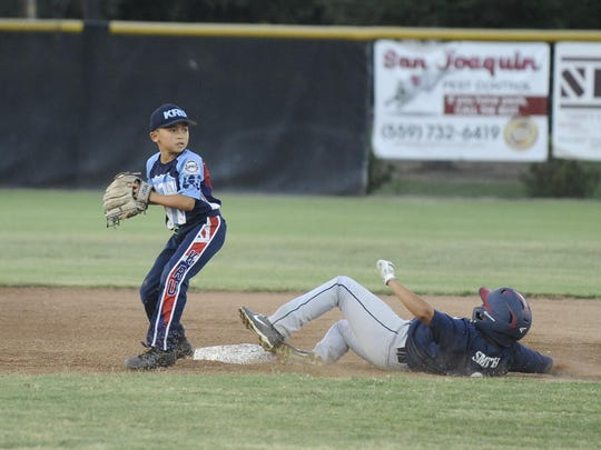 Hawaii gets the tag out at second base as Los Altos from Long Beach slides during the Pacific Southwest Regional Tournament at Riverway Sports Park in Visalia on July 22, 2017.