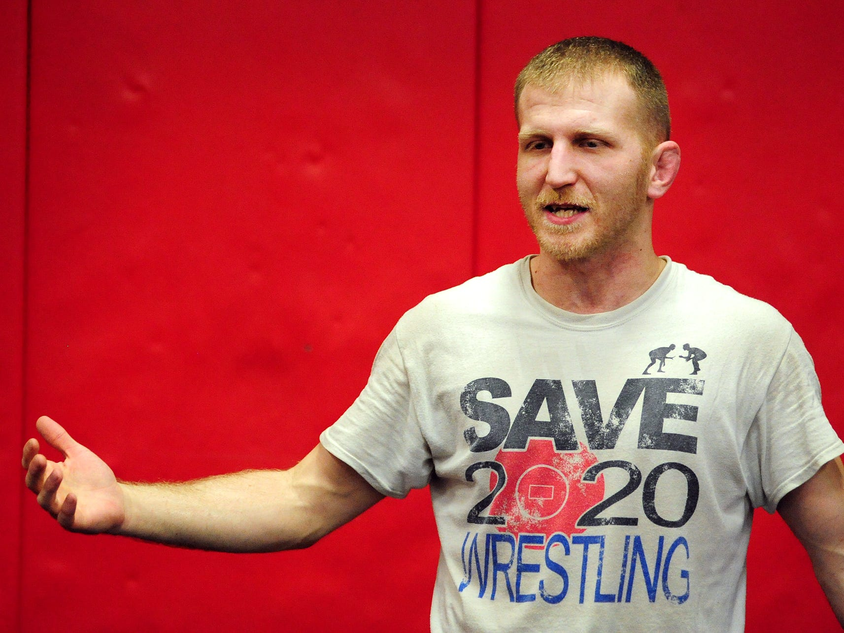 North Salem head wrestling coach Andy Pickett talks to his team during practice at the school on Monday, December 15, 2014.