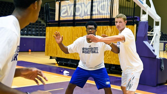 Colby Koontz, right, guards fellow freshman Lane during a drill in practice last summer.