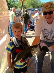 Steve Juiffre of South Burlington with his grandson Cameron weighing in his 18.25-inch long, 3.19-pound largemouth bass. As of Saturday afternoon Cameron was in third place in the Junior Warm Water Division.