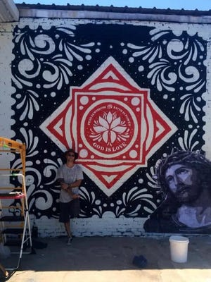 Michael Kasey II is a combat veteran who suffers from PTSD. He painted a religious mural in West Monroe that has since been painted over after not receiving the OK from the city's historic commission. This photo was taken while the mural was in progress.