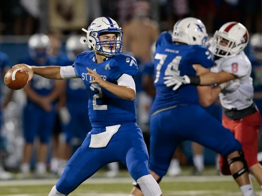 St. Xavier quarterback Chase Wolf (2) drops back to pass in the second half during the high school football game between the Colerain Cardinals and St. Xavier Bombers, Friday, Sept. 2, 2016, at Ballaban Field in Cincinnati. Colerain won 20-14 in overtime.