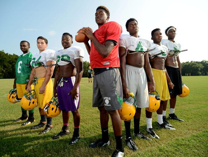 Catholic High School quarterback Z'Khari Blocker is flanked by receivers and running backs, from left, Jawan Purifoy, Kyle Brown, Manta Purifoy, Antwain Adams, Daniel Byrd and Quan Moorer.