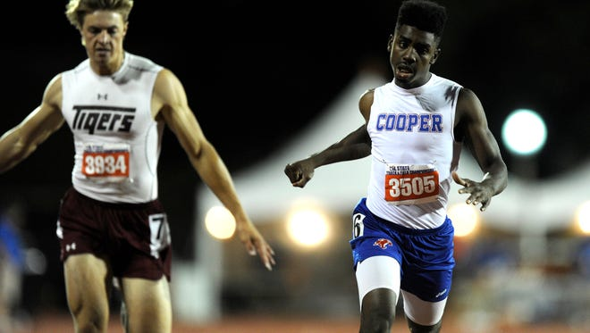 Cooper's Terreon Paige (3505) lunges across the line to finish second in the Class 5A boys 200m during the UIL State Track and Field Championships on Friday, May 12, 2017, at Mike A. Myers Stadium in Austin. Paige had a time of 21.29.