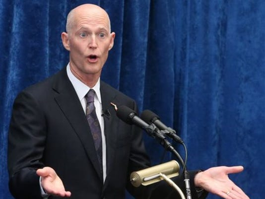 Florida Gov. Rick Scott speaks to the media during a pre-legislative news conference, Wednesday, Jan. 28, 2015, in Tallahassee, Fla. (AP Photo/Steve Cannon)