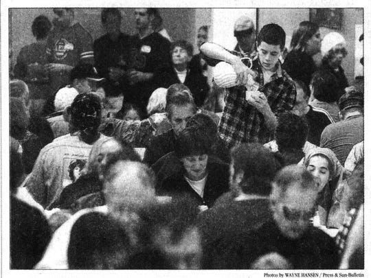 Brian Shea serves those enjoying the meal at Binghamton High School in 2001.