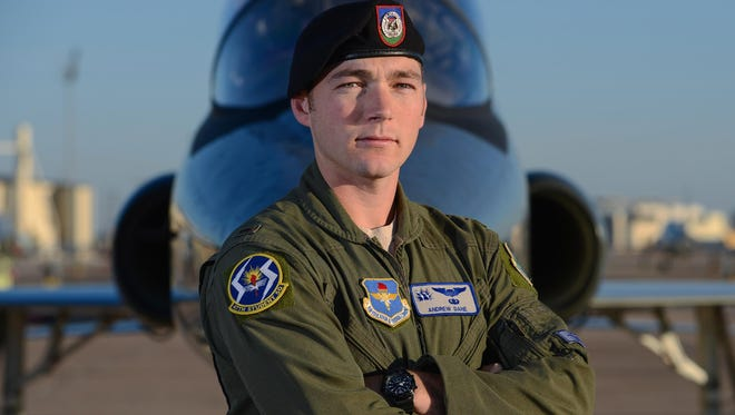 Second Lt. Andrew Dane, a 47th Flying Training Wing pilot graduate, poses for a photo on the flight line at Laughlin Air Force Base, May 25, 2017. With his new wings, Dane is on his way to fly the F-16 Fighting Falcon, an aircraft that he formerly supported as a Tactical Air Control Party specialist.