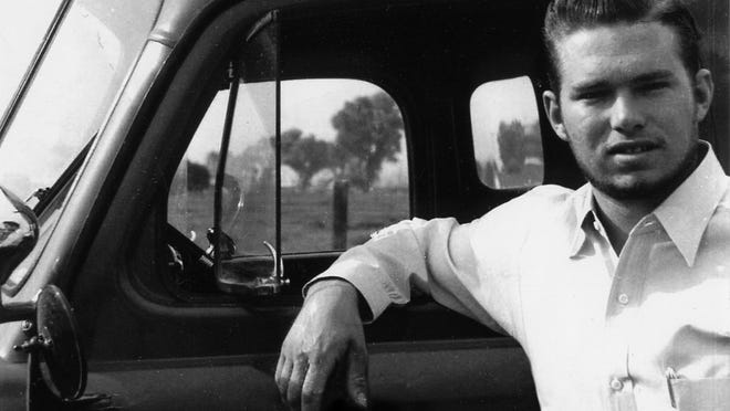A young Paul Messinger with his truck.