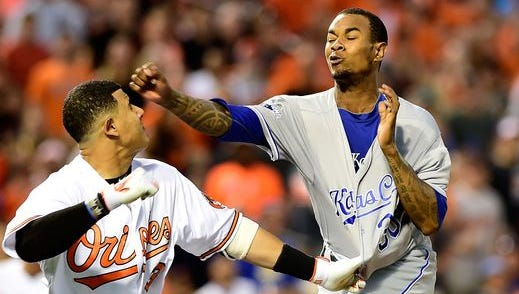 Orioles third baseman Manny Machado charges the mound to fight Royals pitcher Yordano Ventura after Machado is plunked by a pitch.