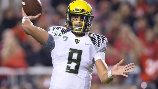Nov 8, 2014; Salt Lake City, UT, USA; Oregon Ducks quarterback Marcus Mariota (8) passes the ball during the first half against the Utah Utes at Rice-Eccles Stadium. Mandatory Credit: Russ Isabella-USA TODAY Sports