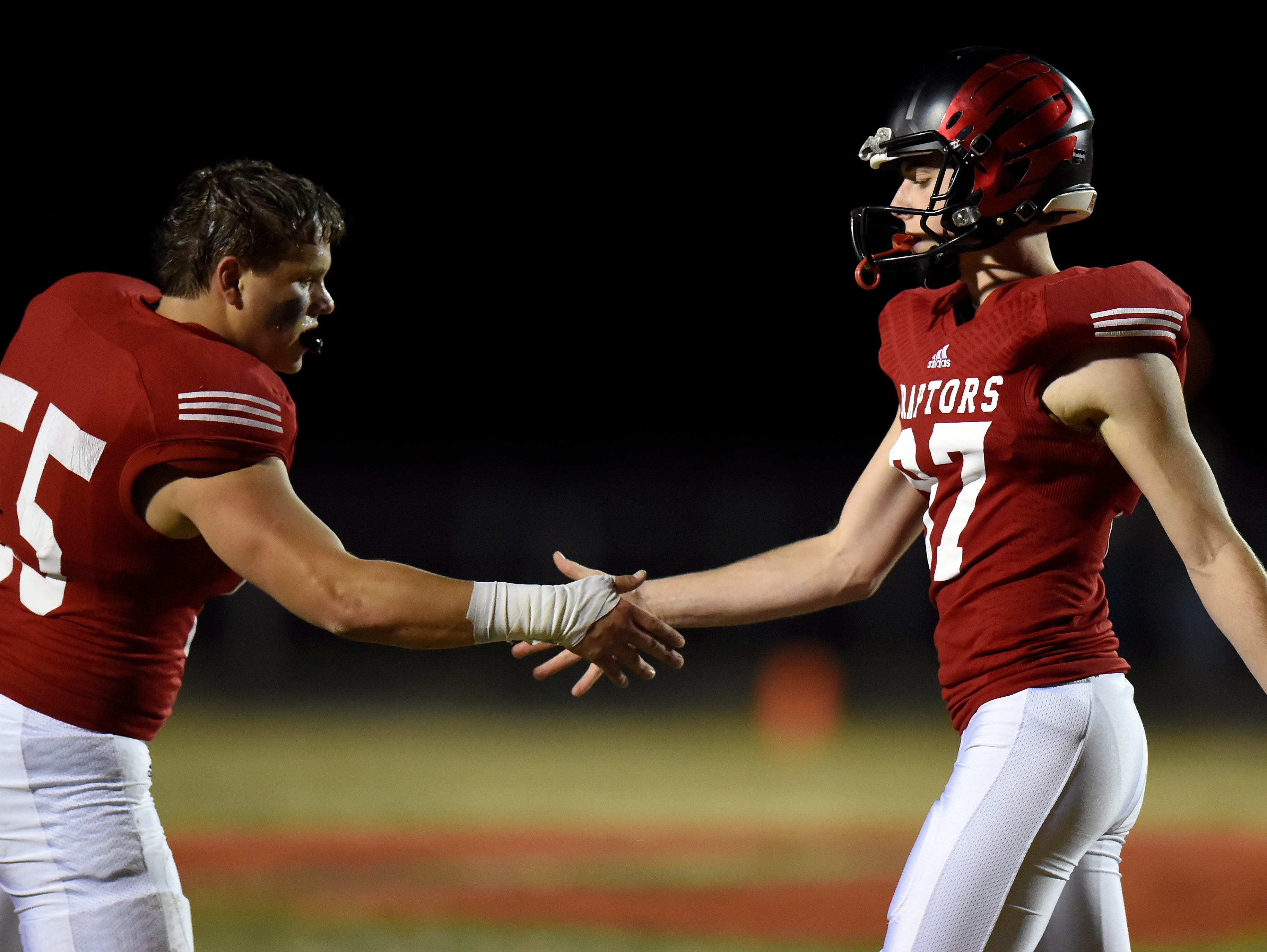Ravenwood kicker Crews Holt, right, is congratulated by Connor Cassin (55) after Crews kicked a field goal against Whitehaven during the first half of an 6A semifinal playoff football game at Ravenwood High School on Friday, Nov. 27, 2015 in Brentwood, Tenn.