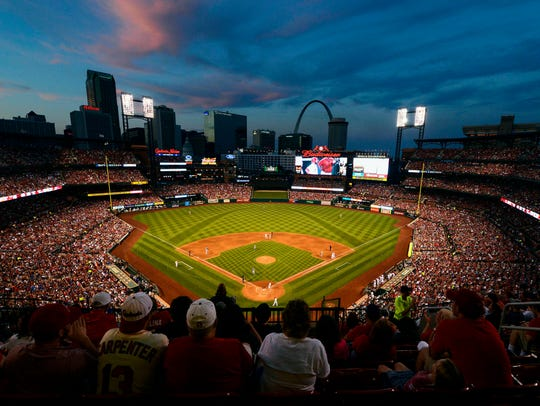 A general view of Busch Stadium as the sun sets and