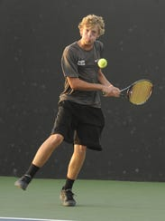 Abilene High's Dylan Haught hits a backhand back to