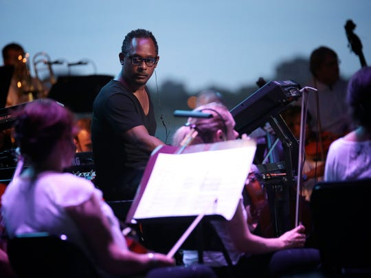 Derrick May performs with the Detroit Symphony Orchestra on Friday, Aug. 14, 2015, at Chene Park in Detroit.