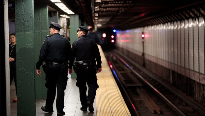 New York City police officers patrol the subway station near Times Square on Nov. 7, 2016.