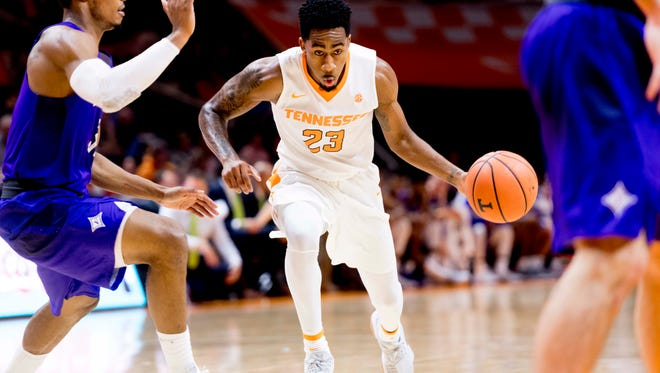 Tennessee guard Jordan Bowden (23) drives the ball during a game between Tennessee and Furman at Thompson-Boling Arena in Knoxville, Tennessee on Wednesday, December 20, 2017.